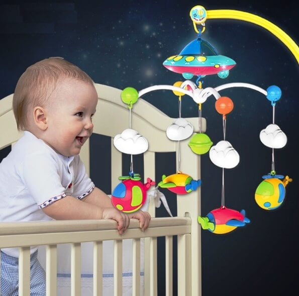 hanging toys in the crib of a newborn